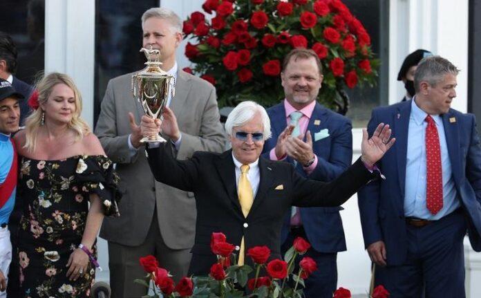 Bob Baffert holds up the winner's trophy